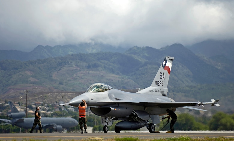 Maintenance crew members recover their F-16 Fighting Falcon after it returns to Hickam Air Force Base, Hawaii, from an air-to-air mission Sept. 8 during Exercise Sentry Aloha. The maintenance crew are from the Texas Air National Guard's 149th Fighter Wing. (U.S. Air Force photo/ Tech. Sgt. Shane A. Cuomo)