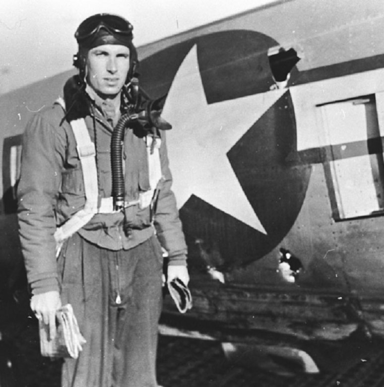1Lt. Raymond L. Knight showing combat damage from a mission he had just flown. (U.S. Air Force photo)