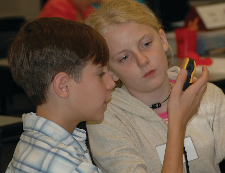 Mooringsport Elementary students, Tyler Castie and Destiney Caskey, learn how to use a Global Positioning System device Tuesday, Sept. 12, at STARBASE La.'s satellite classroom. (U.S. Air Force photo/Tech. Sgt. Sherri Savant)
