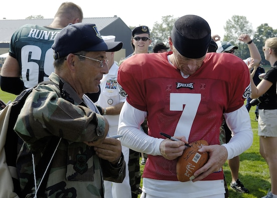 MCGUIRE AFB, NJ -- Air Force reservist Tech. Sgt. William Ciarrocchi gets an autograph from Jeff Garcia, backup quarterback for the Philadelphia Eagles August 14. Military members from the Delaware Valley spent the day at the Eagles Training Camp at Lehigh University meeting the players and watching the preseason practice as part of the team's military appreciation day. US Air Force Reserve photo by Kenn Mann