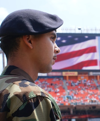Senior Airman Julian DeJesus III, 482nd Security Forces, was one of 50 reservists of Homestead Air Reserve Base, Fla. to take part in a tribute to military members during opening ceremonies of the Dolphins first home-game of the season Sep. 17. The Airmen joined about 150 soldiers and sailors from South Florida unfurling an enormous field-size American Flag at the event. (Air Force photo by Dan Galindo)