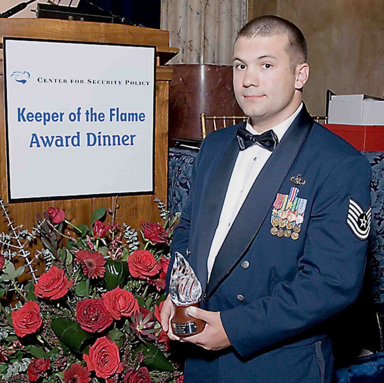 Tech. Sgt. Stephen Achey, 682nd Air Support Operations Squadron, was presented the Keeper of the Flame Award Wednesday in Washington, D.C., for his acts of heroism while in Afghanistan. (U.S. Air Force photo/Dennis Kan)