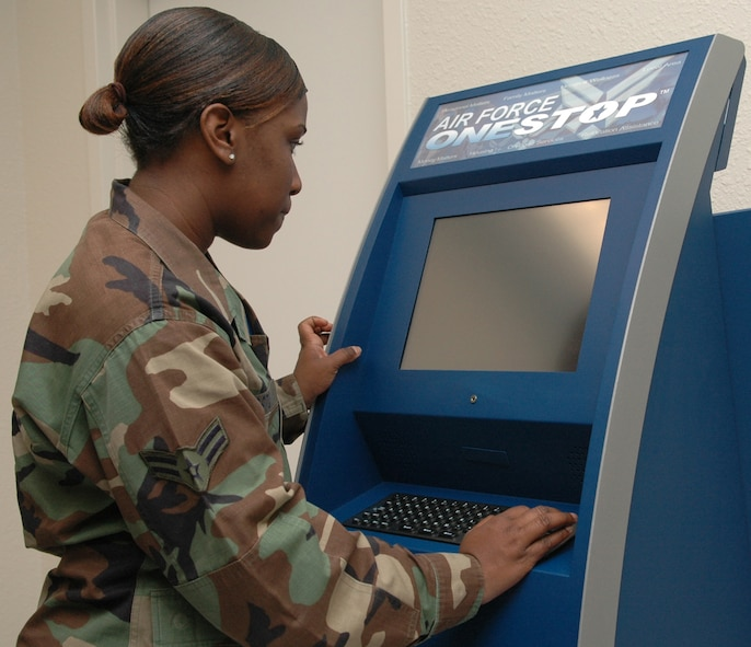 "Airman first class Traci Coston, 49th Comptroller Squadron, 49th fighter wing, Holloman Air Force Base, New Mexico signs on to the new MyPay kiosk. The MyPay kiosk is the ""Air Force one stop shop"". It will allow military members and civilians to check leave and earning statements to help answer any financial questions by use of a touch screen computer available at the Base Exchange during hours of operations. (USAF photo by SRA Jessica De Pierri)"