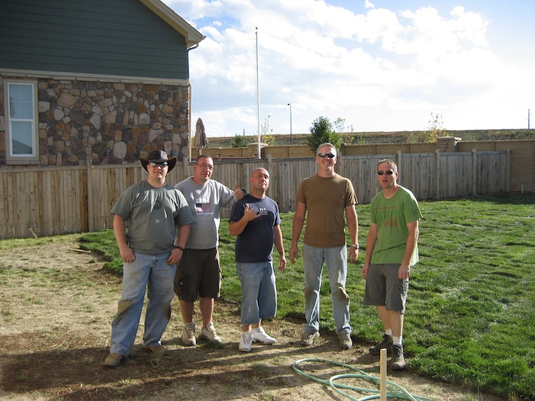 BUCKLEY AIR FORCE BASE, Colo. -- Staff Sgt. Michael Cetin, Tech. Sgt. Stephen Miller, Staff Sgt. Jonathan Sergi, Master Sgt. Paul Stephens and Tech. Sgt. Kenneth Sheldon, all from the 566th Information Operations Squadron, pose for a picture after laying 480 rolls of sod to help Gayla Romanowsky, a deployed member's spouse. Jessie Smith (not pictured) also helped with the project. (Courtesy photo)