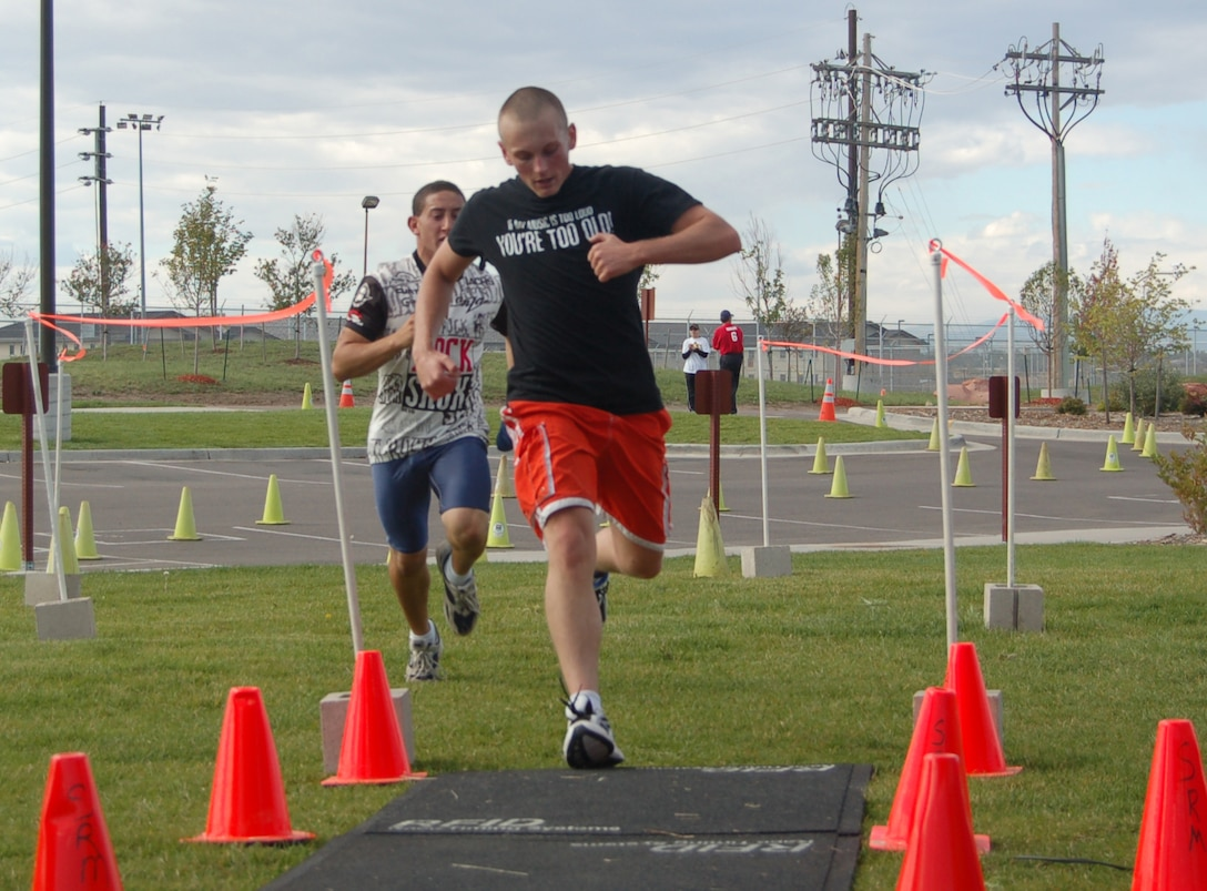 BUCKLEY AIR FORCE BASE, Colo. -- David Kanefsky and Sean Beagle, mini triathlon contestants, cross the finish line in Saturday's event. (U.S. Air Force photo by Senior Airman Jacque Lickteig)