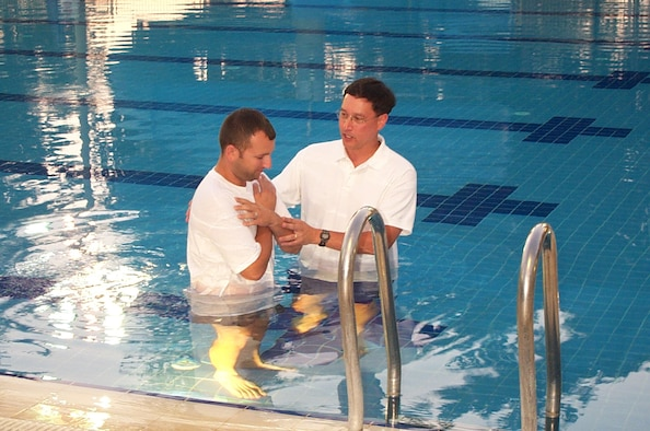Chaplain (Maj.) Kenneth Reyes, 39th Air Base Wing Chaplain, baptizes a chapel member at the base pool. (Courtesy photo)