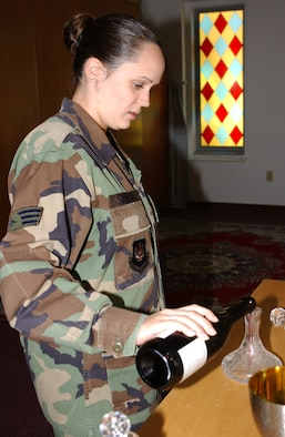 Senior Airman Jacqulyn Sanford, 39th Air Base Wing chaplain assistant, prepares for Sunday's communion. (U.S. Air Force photo by Airman 1st ClassTiffany Coulburn)