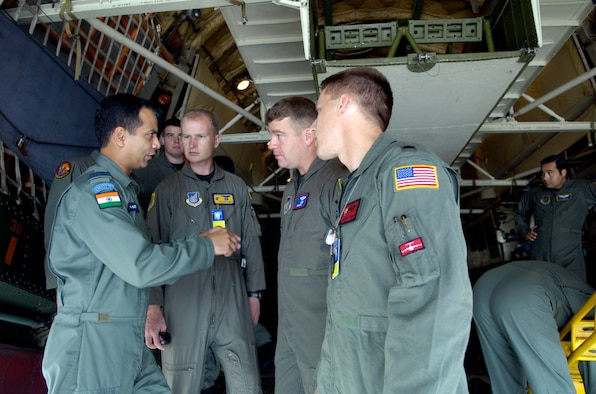 Wing Commander P. Naiwal talks about the capabilities of the IL-76 medium cargo jet to members of the 15th Airlift Wing at Hickam Air Force Base, Hawaii. Sept. 20, 2006. Wing Commander Naiwal is a pilot with the Indian Air Force. The Indian Air Force is flying members of the 15th Airlift Wing to show their American counter parts what their aircraft is capable of. (U.S. Air Force photo/ Tech. Sgt. Shane A. Cuomo)