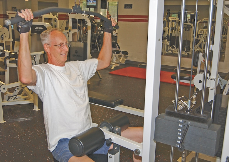 Steve Lamb works out at the fitness center. Mr. Lamb is one of two dozen retirees known as the Q-tip crowd who take advantage of the benefits available to them at the fitness center.
