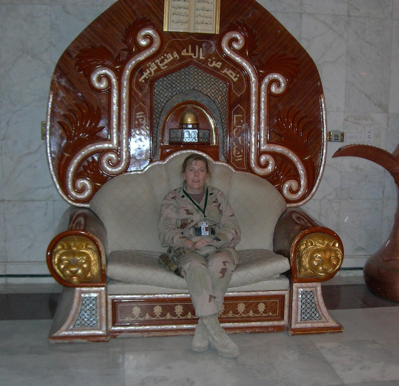 Lt. Col. Deann Lehigh sits in the throne of one of Saddam Hussein's former palaces while on duty in Iraq.