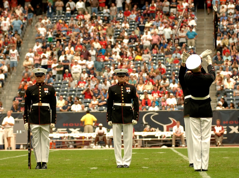 The Marine Corps Silent Drill Team from Washington, D.C., performs in front of more than 70,000 fans at Reliant Stadium in Houston at halftime of the Houston Texans and Washington Redskins National Football League game Sept. 24. The Texans honored military servicemembers in their Salute to the Military day. (U.S. Air Force photo/Tech. Sgt. Cecilio M. Ricardo Jr.)