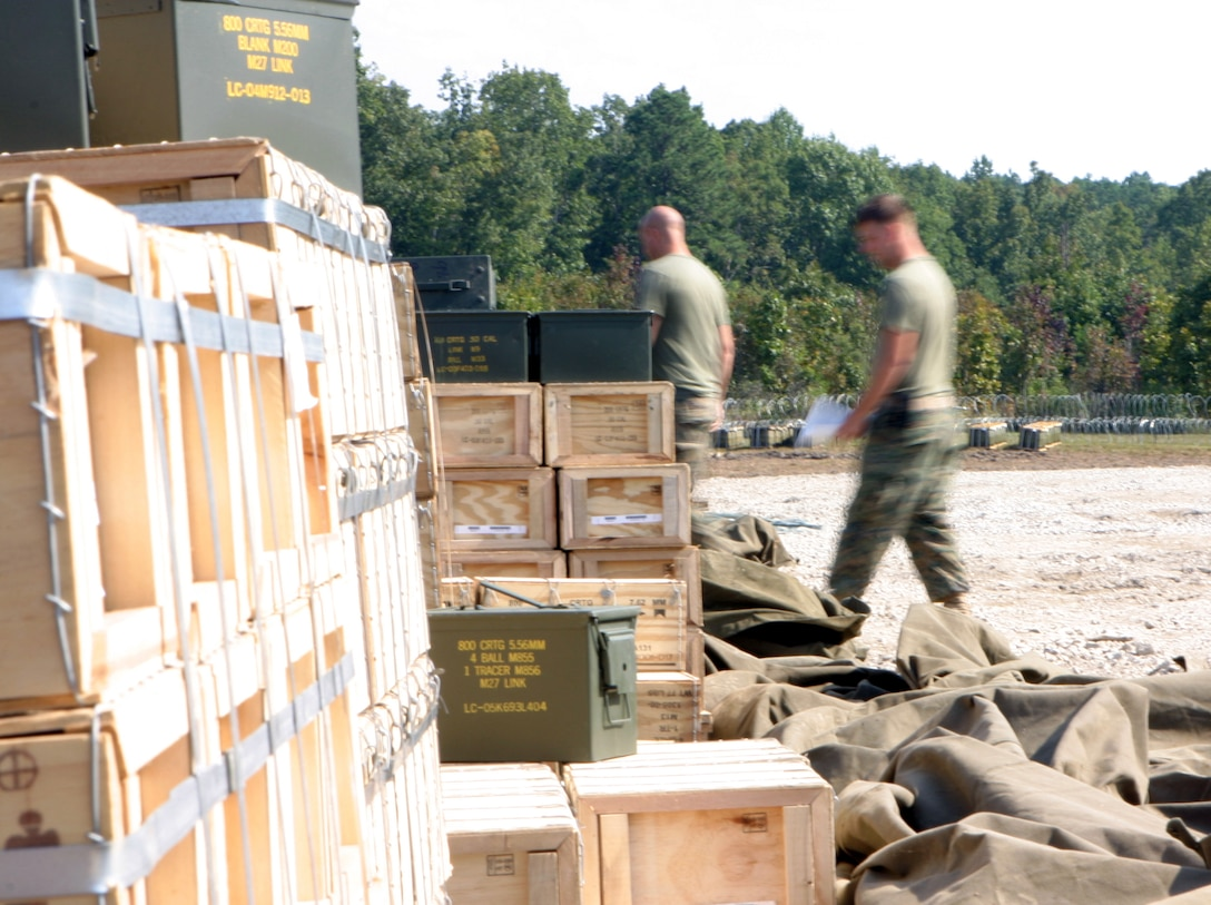 Corporal Sean P. McMillan, an ammunition technician from the 26th MEU's CLB-26, counts 40mm grenade rounds while preparing an ammunition order during exercises at Fort Pickett, Va., Sept. 27, 2006.  The Marines created a Field Ammunition Supply Point and supplied all the ammo for both the Marine Expeditionary Unit Exercise and Training in an Urban Environment Exercise.