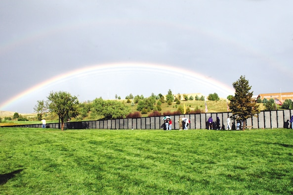 """Visitors, veterans and family members observe the traveling Vietnam Wall in Pierre Saturday, Sept. 16, after the dedication ceremony. """"The Wall"""" is a replica of the Vietnam Veterans National Memorial located in Washington, D.C. (Photo by 1st Lt. Carrie L. Kessler)"""