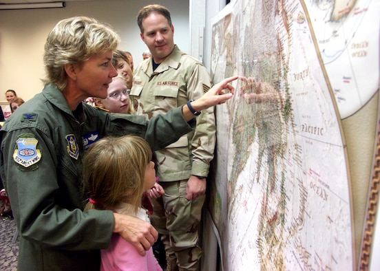 Colonel Maryanne Miller, the commander of the 932nd Airlift Wing, explains to children of her reservists how they will be transported overseas for a deployment.  Looking on with interest before heading out is Staff Sergeant Dale Dragert.  The Air Force Reserve Command unit is located at Scott Air Force Base, Ill.
