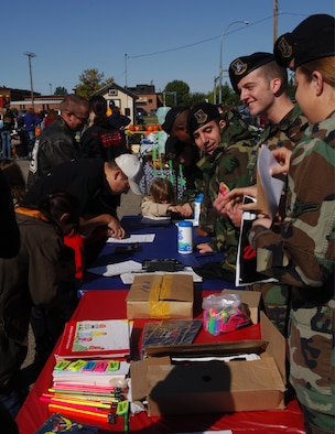MINOT AIR FORCE BASE, N.D. -- Members from the 5th Security Forces Squadron take fingerprints and promote the Drug Abuse Resistance Education Program here during  fall festival Sept. 23. The fall festival is an annual base event to kick-start the fall season. (U.S. Air Force photo by Airman 1st Class Joe Rivera)