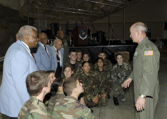MCGUIRE AFB, N.J. -- Gen. Duncan J. McNabb, Air Mobility Command commander tells Reserve Junior Officer Training Corp cadets from Old Bridge High School, Old Bridge, N.J., about the Tuskegee Airmen before a group picture is taken with four original members. General McNabb was guest speaker at the Air Force birthday celebration held Saturday at McGuire Air Force Base, N.J. USAF photo by Kenn Mann.