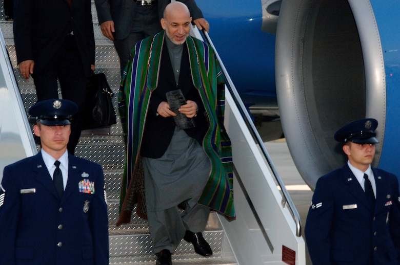 Afghanistan's President Hamid Karzai exits an aircraft on the flightline at MacDill Air Force Base, Fla., Sept. 26. President Karzai visited with the commander of United States Central Command during his visit to the United States this week. (U.S. Air Force photo/Senior Airman Jason Robertson)