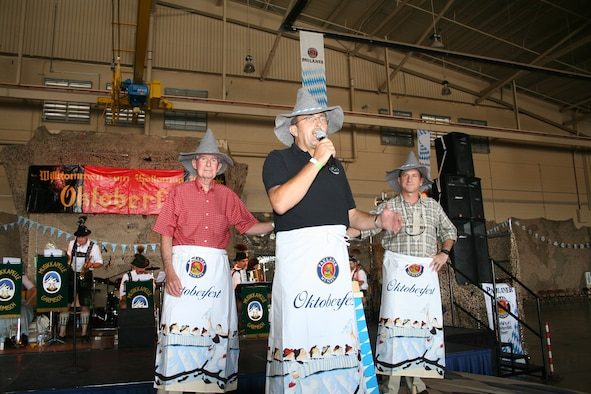 Mr. Don Carrol, mayor of Alamogordo, Col. Manfred Molitor, German air force Flying Training Center commander, and Col. David Goldfein, 49th Fighter Wing commander, rode into Oktoberfest on a platform and tapped a keg to start the event.