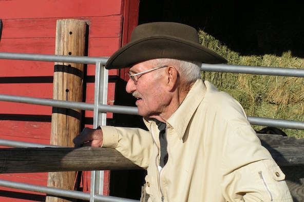 Eighty-three-year-old Walter Henley peers throught the fence at his horse, Big Buck, who is housed a the Malmstrom stables. Besides being a veteran of three wars, Mr. Henley is a trusted advisor to many members of the Big Sky Riders Saddle Club.