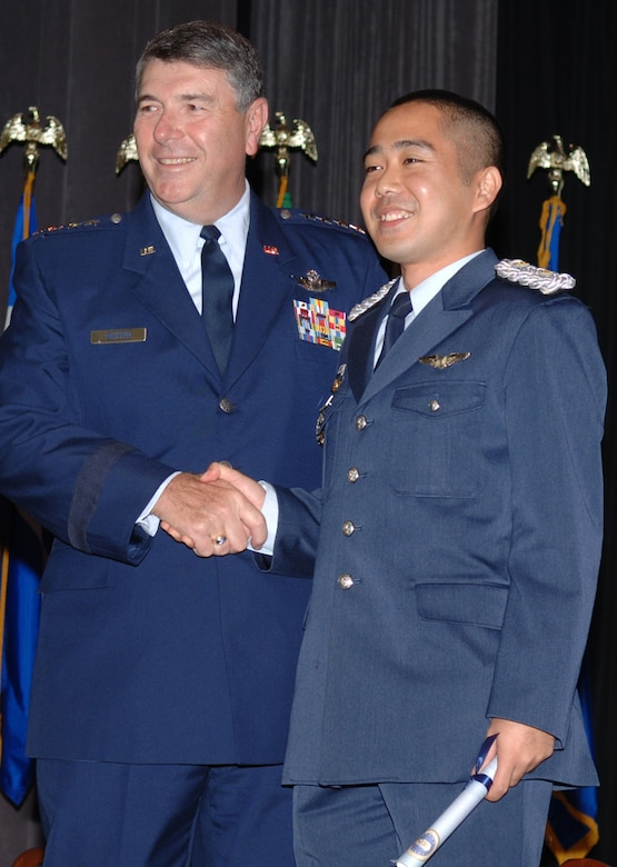 COLUMBUS AIR FORCE BASE, Miss. - General Paul V. Hester, commander Pacific Air Forces, congratulates Japan Air Self Defense Force 1st Lt Masakazu Kamimura, Kobe, Hyogo, Japan, after receiving his USAF silver wings.  General Hester addressed the Specialized Undergraduate Pilot Training Class 06-15 during a graduation ceremony.  He also met and spoke with local leaders. (Air Force photo by Senior Airman John Parie)