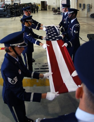 MINOT AIR FORCE BASE, N.D. -- Members of the base Honor Guard fold the U.S. flag in honor of servicemembers who have been captured as prisoners of war or are missing in action during a special retreat ceremony at Dock 7 Sept. 22. (U.S. Air Force photo by Airman First Class Joe Rivera)