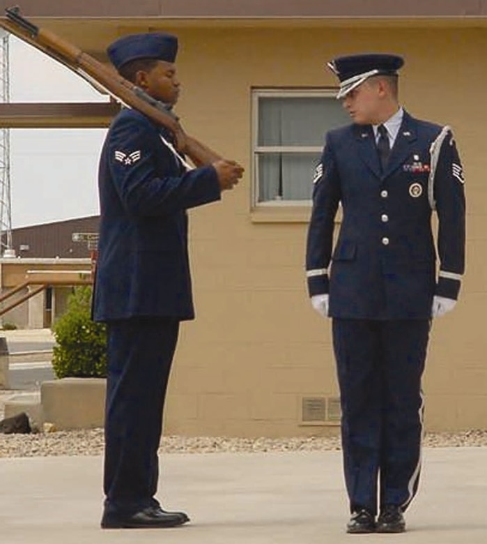 Staff Sgt. Jason Estrada, 49th Medical Support Squadron and Holloman Guardsman, looks to the right at another Guardsman during a graduation sequence.