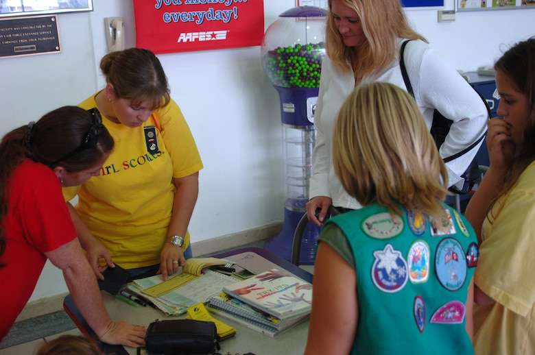 Patricia Presley, committee chairperson for Adana-Incirlik Neighborhood Girl Scouts, goes over the game plan for Girl Scout registration with volunteers at the Base Exchange Sept. 23. (U.S. Air Force photo by Airman 1st Class Nathan Lipscomb)
