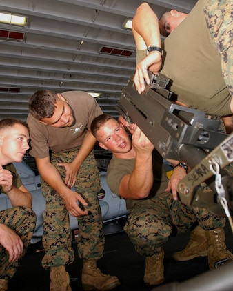 PACIFIC OCEAN (Oct. 2, 2006)--Marine SSgt. Anthony Alongi assigned to the 5th Battalion 11th Marines Sierra Battery Company attached to the 15th Marine Expeditionary Unit/Special Operations Capable (MEU/SOC) deployed aboard USS Boxer (LHD 4) shows fellow Marines how to operate an Mk19 machine gun.  Boxer is the flag ship for the Boxer Expeditionary Strike Group (BOXESG), operating out of San Diego, Calif.; which is reporting operationally to Commander, Expeditionary Strike Group (ESG) 7/ Task Force (CTF) 76, the Navy's only forward-deployed amphibious task force.  U.S. Navy photo by Mass Communication Specialist Seaman Derek R. Sanchez. (RELEASED)