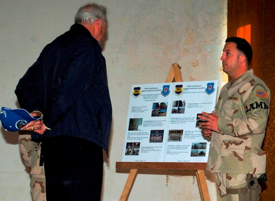 ALI BASE, Iraq -- Staff Sgt. Joseph Bozsoki, a Kadena munitions Airman, explains the munitions mission at Ali Base, Iraq, March 28 to Secretary of the Air Force Michael Wynne.  Secretary Wynne's visit was part of a two-base tour of Air Force units in Iraq. (Air Force/Master Sgt. James A. Rush)