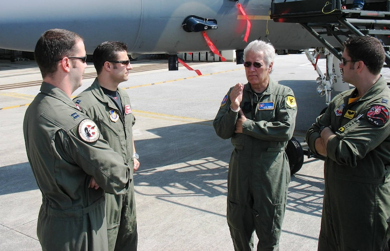 KADENA AIR BASE, Japan -- Alex Trebek, host of the Jeopardy game show, talks to U.S. Air Force fighter pilots at Kadena March 31 during a Jeopardy game show USO tour of Japan.  Speaking with Mr. Trebek are (from left) Capt. Phil Colomy, F-22 pilot with the 27th Fighter Squadron, Langley Air Force Base, Va.; Capt. Kirby Enser, F-15 pilot with the 67th Fighter Squadron, Kadena Air Base; and Capt. Jonathan Airhart, also an F-22 pilot with the 27th Fighter Squadron.  The two Langley pilots are here on the F-22 stealth fighter's first overseas deployment.  During the Jeopardy show's two-day trip to Kadena, Mr. Trebek and show staff also toured an F-22, a KC-135 Stratotanker, an E-3 AWACS (Airborne Warning and Control System), an F-15C fighter, and an HH-60 helicopter.  The F-22 is temporarily based at Kadena on its first overseas deployment from Langley Air Force Base, Va.  Kadena residents were allowed to try-out to be contestants on Jeopardy, as well.  (Air Force/Senior Master Sgt. Kenneth Fidler)