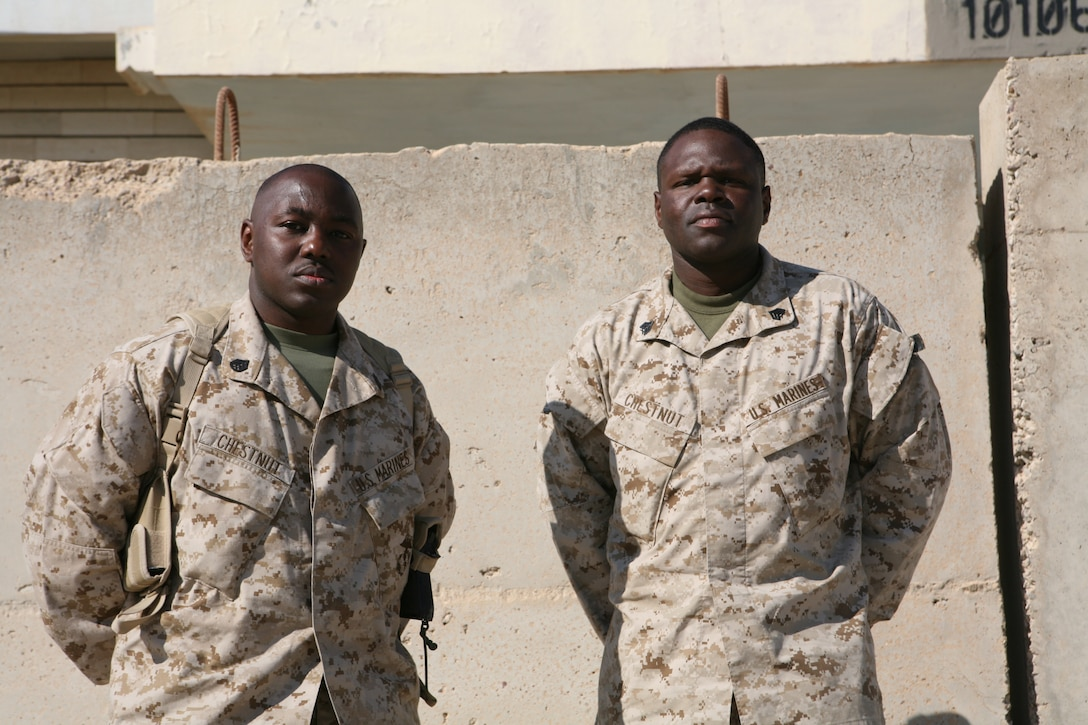 Staff Sgt. Kevin Chestnut, an information systems and computers/ tactical electronic reconnaissance process/evaluation system technician, and cousin Sgt. Russell Chestnut, a supply chief for 1st Battalion, 2nd Marines, 2nd Marine Division, April 3 are currently deployed here for the second time. Kevin and Russell are two of the nine active duty Marines in the family that are currently serving the Corps.