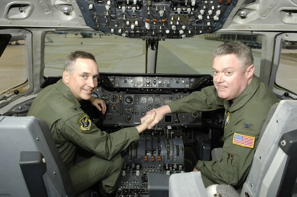 Col. Rick Martin, 305th Air Mobility Wing Commander, and Col. James Kerr, 514th Air Mobility Wing Commander, demonstrate a visible partnership together in the flight deck of a McGuire KC-10 aircraft. The active duty and reserve wings have enjoyed successful Total Force Integration since 1968. Total Force Integration at McGuire Air Force Base is a seamless operation where the 305th and 514th Air Mobility Wings share personnel, equipment, facilities and supplies to support a common mission. (U.S. Air Force photo/Ken Mann)