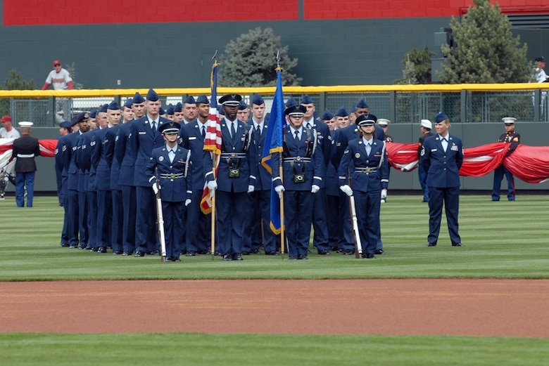 DENVER – More than 45 Air Force members from Buckley Air Force Base stand in formation during the Colorado Rockies' opening-day ceremonies at Coors Field on April 2. The Rockies were defeated by the Arizona Diamondbacks 8 - 6. (U.S. Air Force photo by Senior Airman Alex Gochnour)
