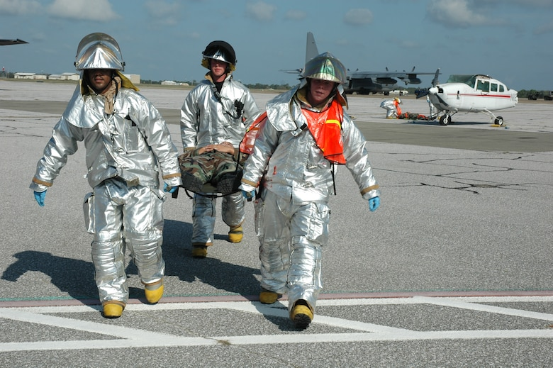 EGLIN AIR FORCE BASE, Fla. -- Eglin firemen carry a victim to the medical staging area during the major accident readiness exercise April 3 after responding to a simulated F-16 crash. The MARE was in preparation for the 2007 Eglin Air Show April 14-15. There were two other incidents that tested Eglin Airmen's emergency response capabilities: a vehicle borne chemical weapon attack and a bomb threat on a C-130 aircraft. (U.S. Air Force Photo by Staff Sgt. Mike Meares)
