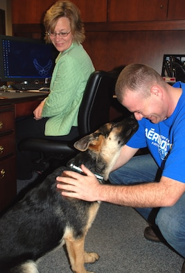 Airman Tyler McGowan brings man's best friend to work to meet members of the 932nd Airlift Wing command section.
