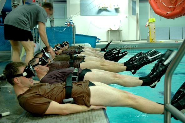 FAIRCHILD AIR FORCE BASE, Wash. -- Phase two candidates perform flutter kicks while wearing their masks and fins. An instructor walks the line filling the trainees' masks with water. Trainees undergo an entire week of exercises that will test them both physically and mentally. (U.S. Air Force photo/Staff Sgt. Larry Carpenter)