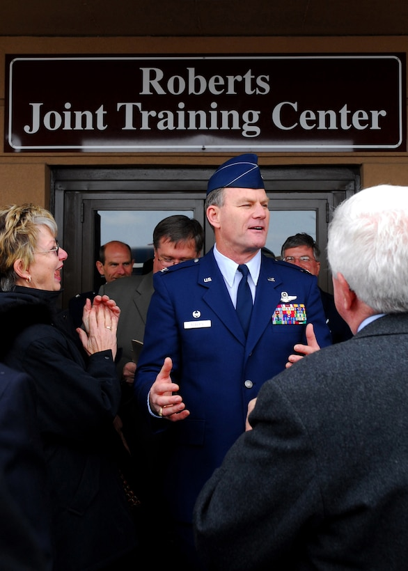 Colonel James B. Roberts addresses wellwishers after being surprised with the naming and dedication of the Roberts Joint Training Center at the Niagara Falls Air Reserve Station. (U.S. Air Force photo/Tech. Sgt. Karl C. Vester)