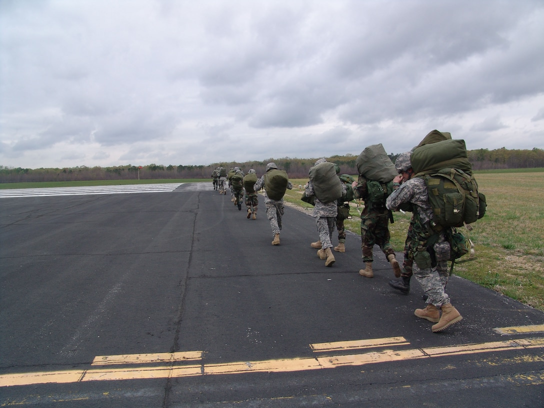 Paratroopers from the 861st Quartermaster Company in Nashville, Tenn., march back to the runway at Arnold Air Force Base's airfield after parchuting during a mock-deployment exercise on base. (Photo by Claude Morse)
