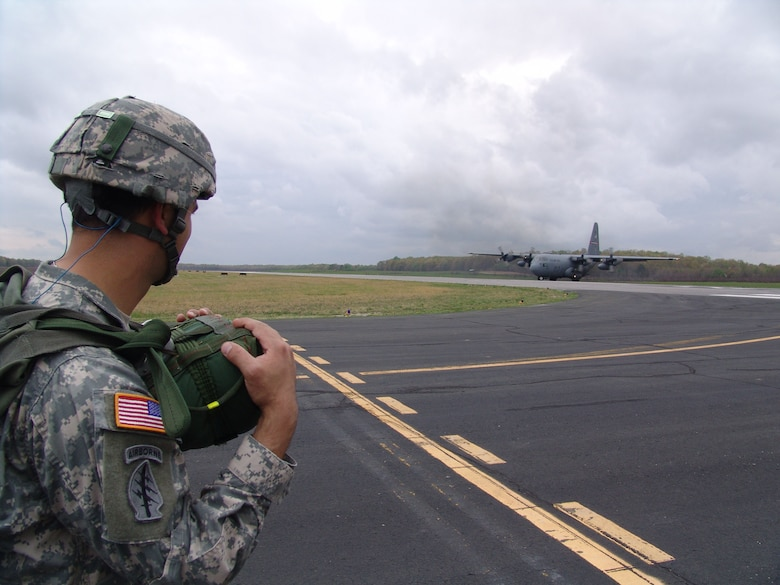 Army Reserve Capt. Mark Lane, commander of the 861st Quartermaster Company in Nashville, Tenn., watches the Tennessee Air National Guard C-130 he jumped from taxi in at Arnold Air Force Base's airfield during an exercise held there March 31 - April 2.  (Photo by Claude Morse)