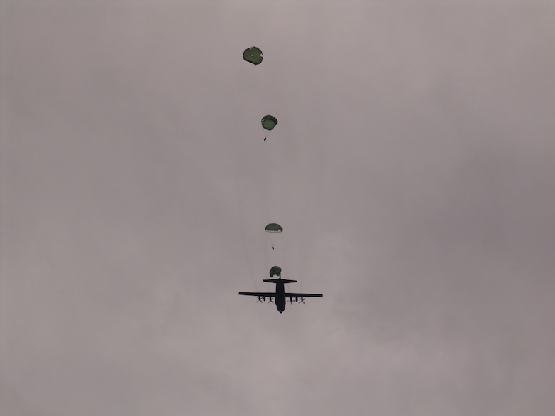Air Reserve paratroopers from the 861st Quartermaster Company in Nashville, Tenn., jump out of a Tennessee Air National Guard C-130 Hercules over Arnold Air Force Base, Tenn., April 1 during a mock-deployment exercise.  (Photo by Claude Morse)