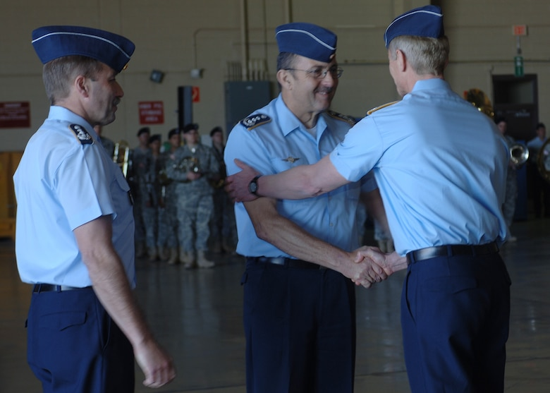 Col. Heinz Joachim Hecht, German air force U.S./Canada commander, looks on as Col. Peter Klement, German air force commander, greets former German Air Force Commander Manfred Molitor after the change of command ceremony.