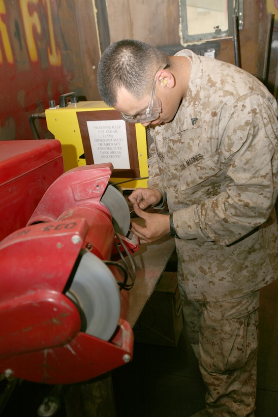 Cpl. German PliegoFlores, Airframe Mechanic and Aviation Welder, prepares a tool for fabrication.  PliegoFlores spends a large amount of his time fabricating and repairing tools for the flying squadrons on Al Taqqadum Airbase, Iraq.