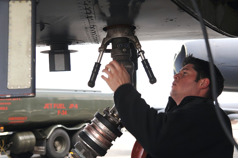Staff Sgt. Sean Ahern refuels one of six B-52 Stratofortress bombers April 6 that are visiting Fairchild Air Force Base, Wash.  The aircraft were evacuated from Andersen AFB, Guam, due to typhoon warnings and arrived at Fairchild April 1. Once the severe typhoon danger has passed, they will return to Andersen.  Sergeant Ahern is a B-52 crew chief from the 2nd Aircraft Maintenance Squadron at Barksdale AFB, La. (U.S. Air Force photo/Airman 1st Class Nancy Hooks)