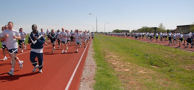 Hundreds of 82nd Training Wing personnel make their way around the 1-mile track April 4 during the wing's monthly run. Participants also completed sit ups and push ups. (U.S. Air Force photo/Mike Litteken)