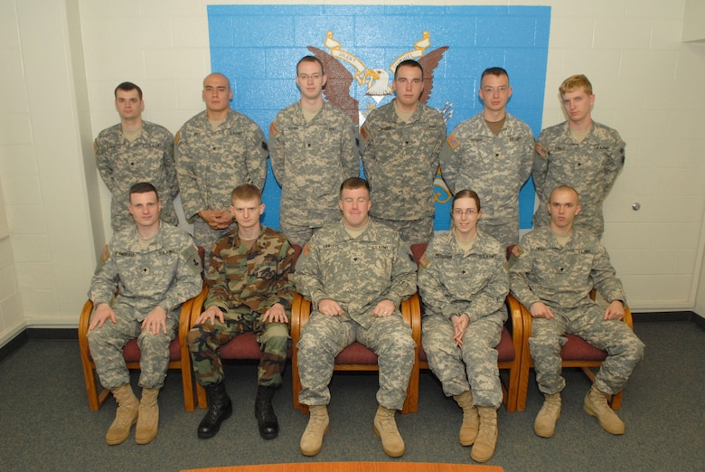 Eleven student Soldiers from the first-ever Iraqi Dialect Course pose for a group photo after a graduation ceremony at the 344th Military Intelligence Battalion. Pictured are (front row from left to right): Specialists Michael D'Angiollilo, Jason Andersen, Jason Lawless, Kady Peterson, Nathan Sweem, (back row from left to right) Bradly Baker, Alexander Endo, Douglas Brown, Joshua Nissen, Kyle Draisey and Paul Price.