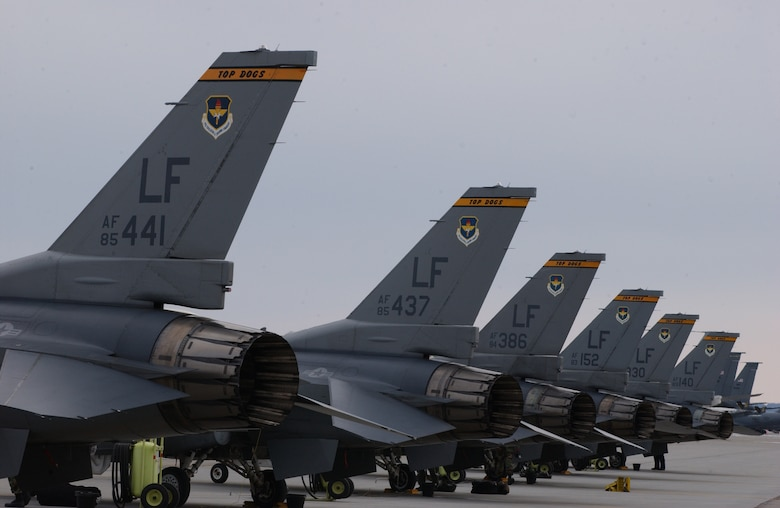 EIELSON AIR FORCE BASE, Alaska -- Eight F-16 Fighting Falcons from the 61st Fighter Squadron, Luke AFB, sit in front of the Thunderdome on April 3 for Red Flag-Alaska 07-1. Red Flag-Alaska is a Pacific Air Forces-directed field training exercise for U.S. forces flown under simulated air combat conditions.  It is conducted on the Pacific Alaskan Range Complex with air operations flown out of Eielson and Elmendorf Air Force Bases. (U.S. Air Force Photo by Airman 1st Class Jonathan Snyder) (Released)