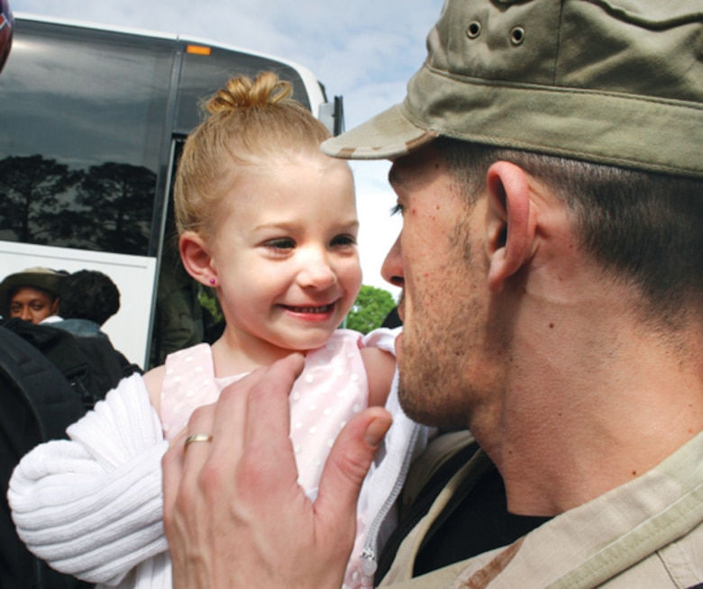 Senior Airman Craig White, 78th Security Forces Squadron, greets his daughter Alexis, 3. (U.S. Air Force photo by Amanda Creel)