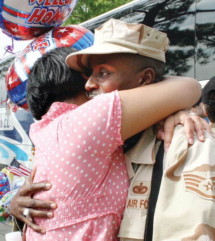 Beunca Smith embraces her husband, Staff Sgt. Jeffery Smith, 78th Security Forces Squadron, when he returned to Robins from a deployment to Sather Air Base in Iraq.(U.S. Air Force photo by Amanda Creel)