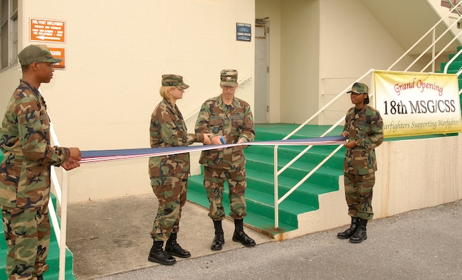 KADENA AIR BASE, Japan -- Col. Max Kirschbaum, 18th Mission Support Group commander, cuts the ribbon on the new 18th MSG Commander's Support Staff office located in building 721B. (Air Force/Airman 1st Class Ryan Ivacic)