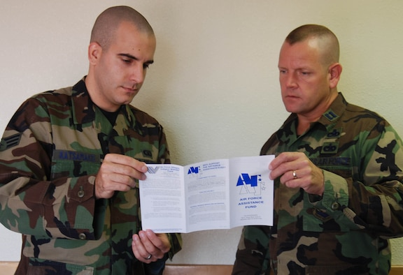 Senior Airman George Katsamakis, from the 36th Operations Support Squadron, and Capt. John Creighton, from the 506th Expeditionary Air Refueling Squadron, review the Air Force Assistance Fund pamphlet.   Both are AFAF unit project officers.  The AFAF campaign ends April 15. ( Photo by Airman Basic Evan Carter/36th Wing Public Affairs)